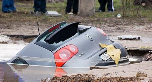 Pothole swallows VW Golf